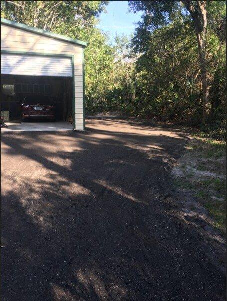 Paved asphalt millings home driveway