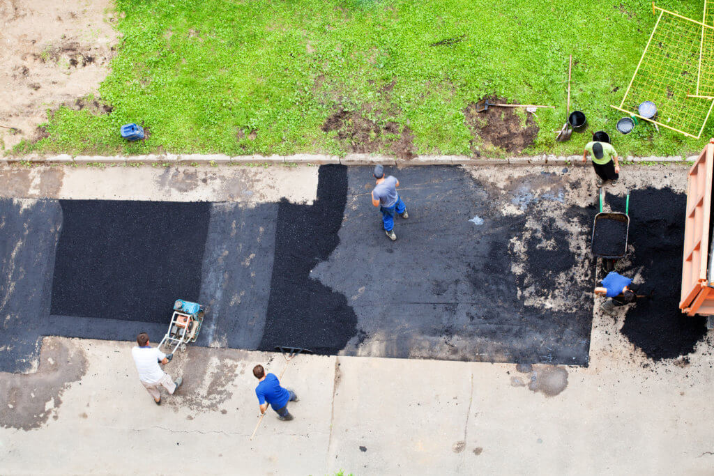 Patching driveway potholes in West Palm Beach